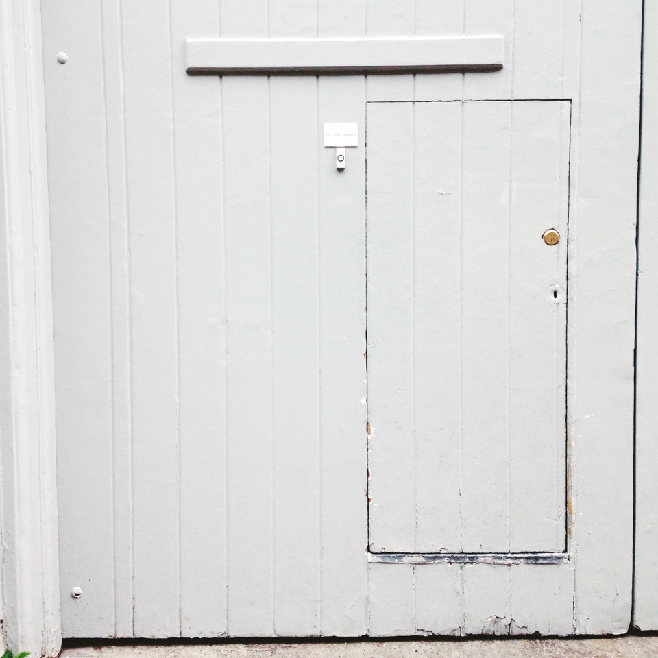 The unassuming front door is the perfect first impression. Photography by Jess Marlor.