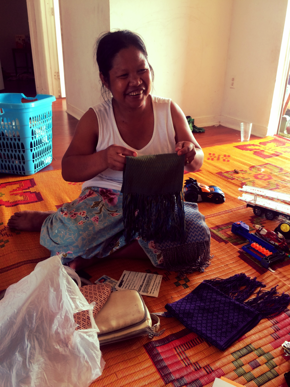 At Mu Mu's home while she showed off one of her hand woven scarves.