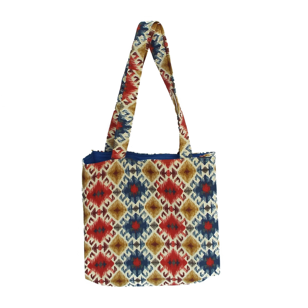 A tote bag made by Khatera. Tote bags can be purchased on The Community Cloth's online store here.