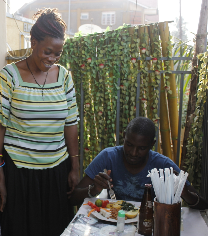 Maama Canadian, Nakawangi Rose, and a happy customer.  ( photo by Moses Bwayo)