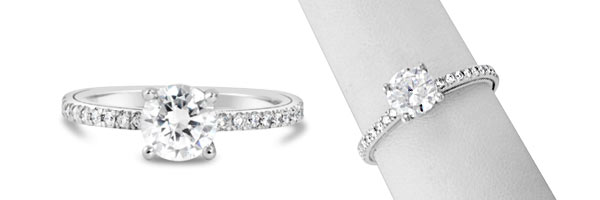 Delicate and timeless, our Forever engagement ring is beautifully crafted with a thin band of prong set diamonds.