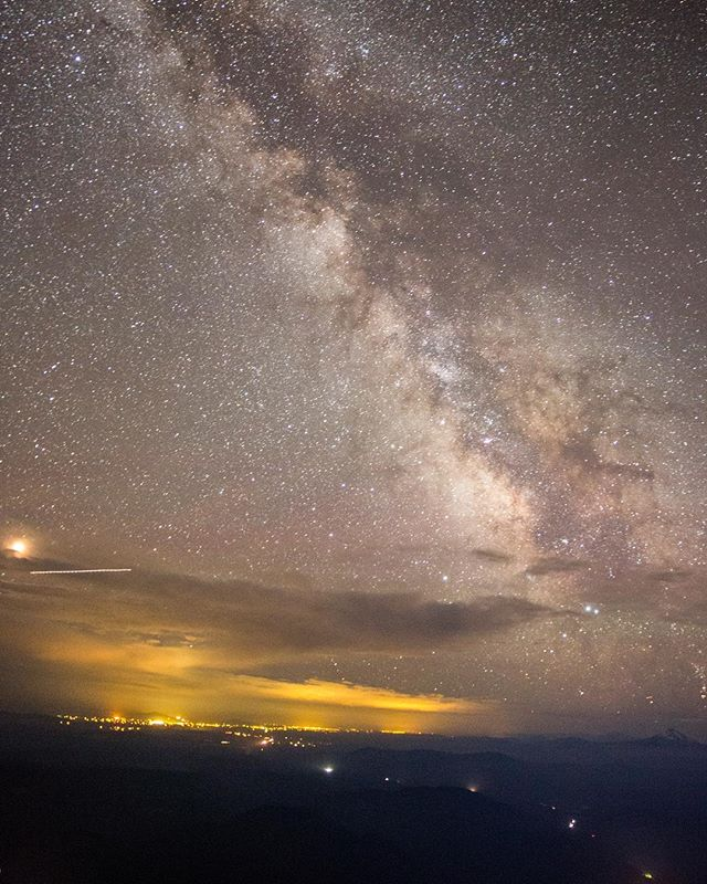 The Milky Way over central Oregon from Mt. Hood. You can see the lights from Madras, Redmond, Bend, and Sisters as well as the cars weaving their way to Portland on Highway 26.