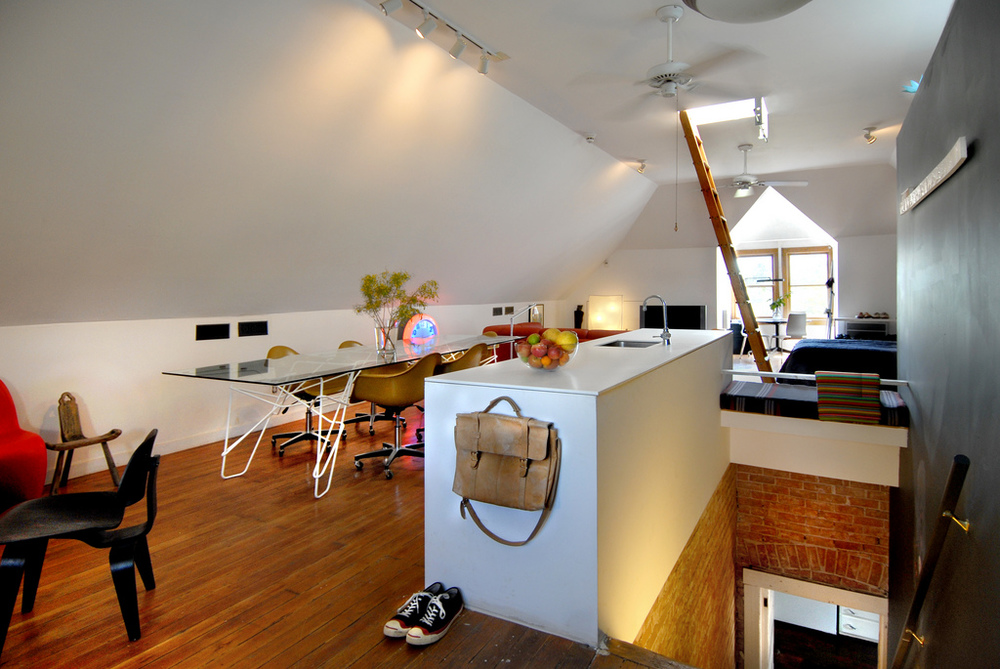 As someone who works from home quite a bit I desperately understand how difficult it can be at times to see your desk from your bed. And while he is currently making strides to keep his home and work life separate, I feel as though he did an incredible job of creating a flow between his personal space and workspace in this loft.
