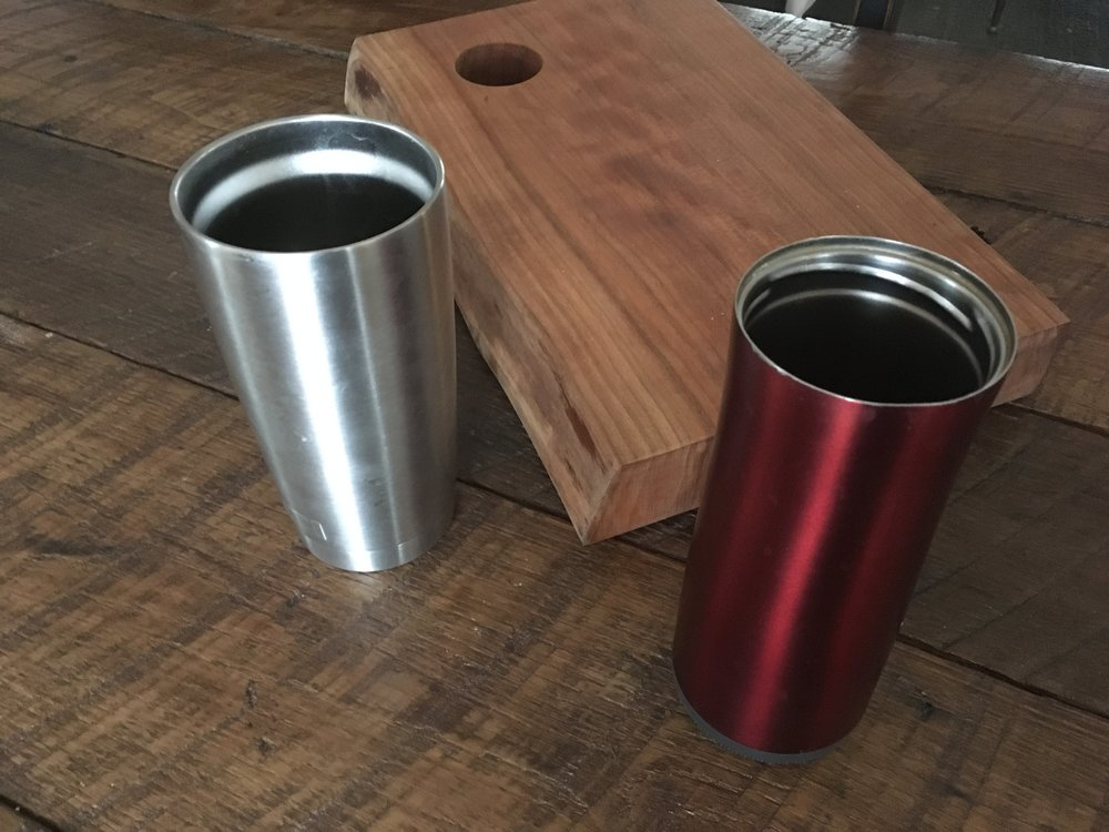 "New silver mug on the left, identified as ""Y"" for the purposes of our experiment. Older red thermal mug on the right, identified as ""C."""