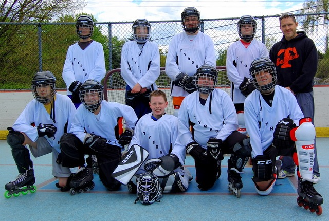 Theron coaches the Tyrone Jr. High roller hockey team.
