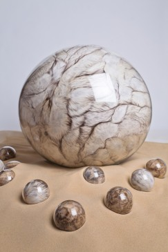 Adeline-de-Monseignat-Mother-HEBLoleta-2012-vintage-fur-pillow-filler-glass-motor-wood-on-2-tonnes-of-sand-main-glass-sphere-68-cm-ten-smaller-spheres-10-cm-variable-installation-243x365-1.jpg