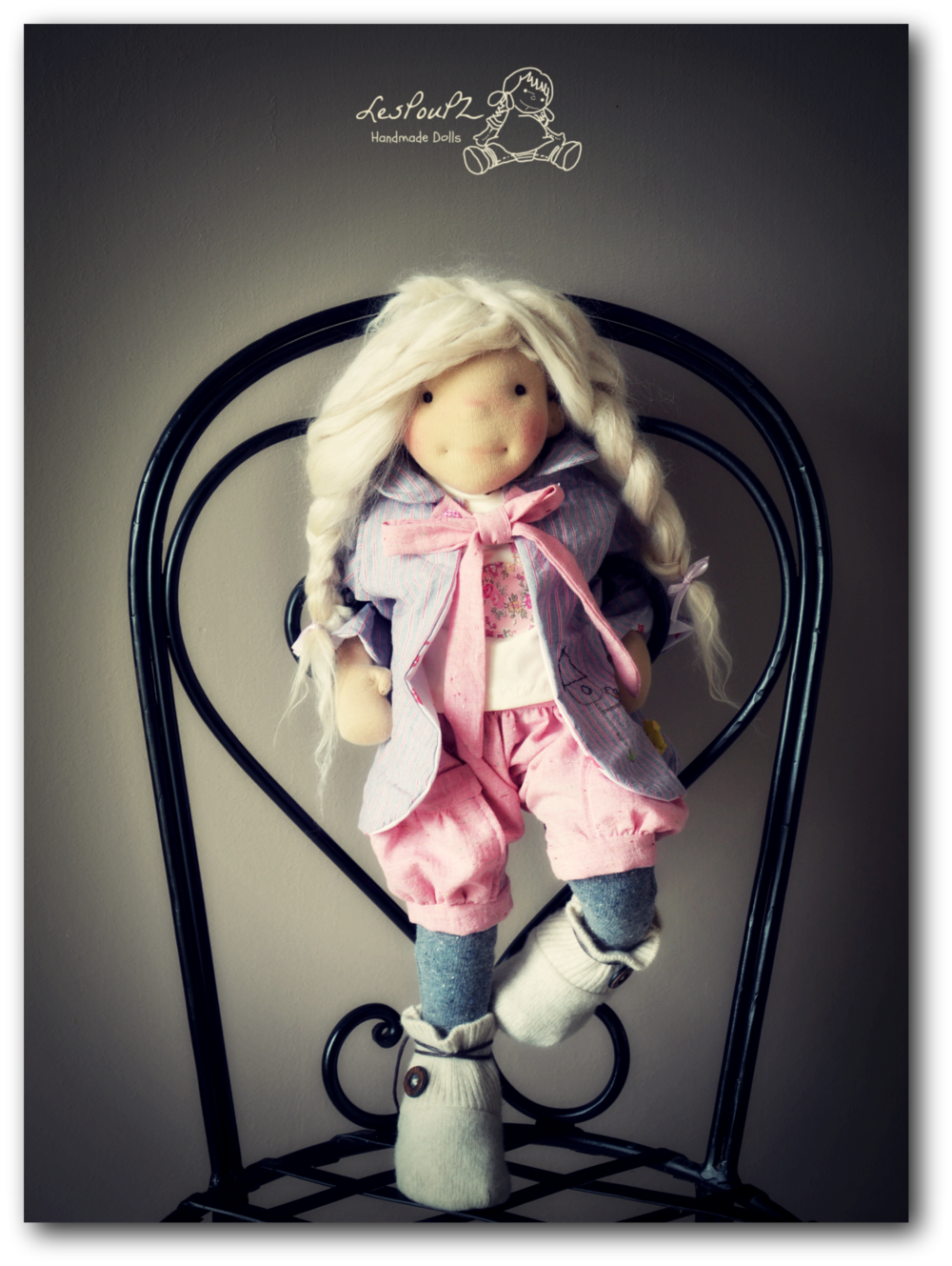 A new outfit for a doll I made last year. Worn here by my model doll, Lola.