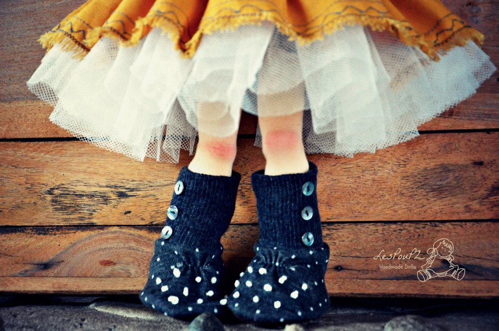 small buttons and dots on her boots