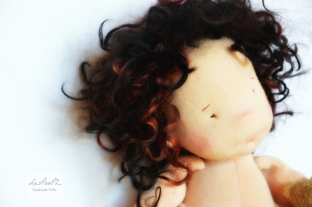 Its hair is made of soft , really soft Kid Mohair locks in black with lovely red highlights