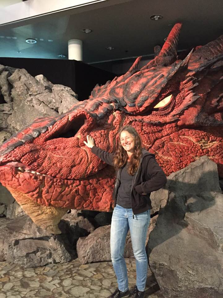 Sabine humming with a dragon in the Wellington airport