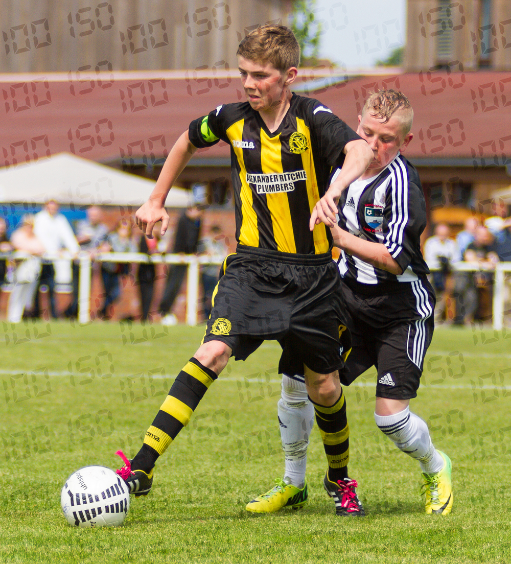 Hutchison Vale's captain holds off an opponent.