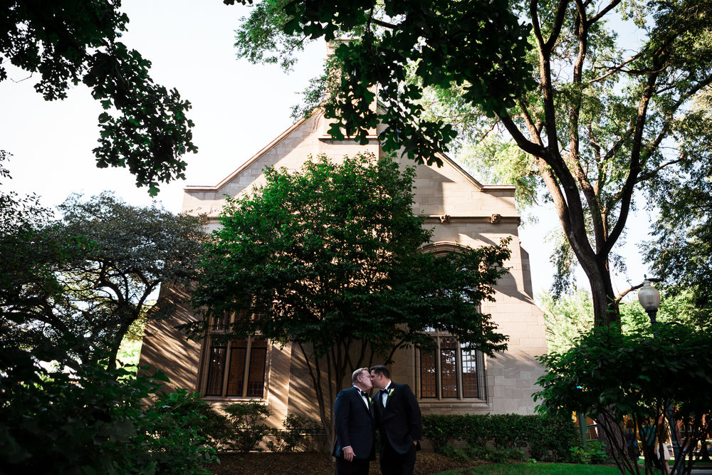 Two grooms kiss at Depaul University's Cortelyou Commons. (c) Amy Stallard - Chicago Wedding Photography