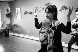Goddess Yoga pose with baby in a sling