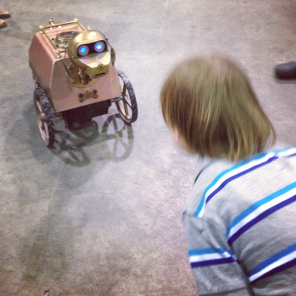 Robot_dog_and_boy_Vancouver_Maker_Faire_©Dana_Reed.jpg