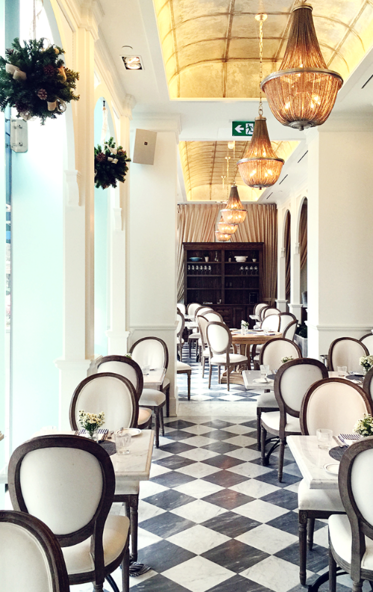 it is a stunning place with a bright white blue and yellow interior its bright and airy decorated in a french style that is classic but inviting not - Large Cafe Interior