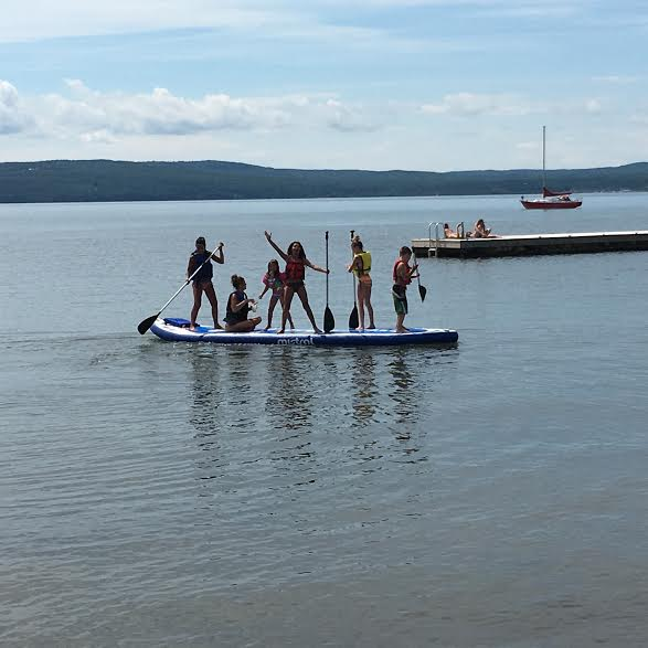 BIG Sup for rent, an 18 foot Sup made by Mistral for 6 adults or as many kids as you can fit on it!