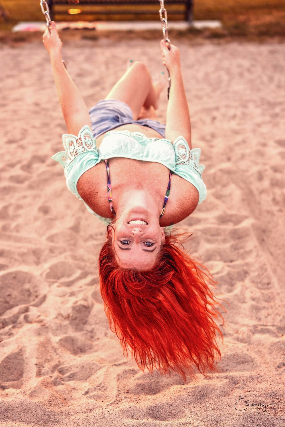 Red head on a swing