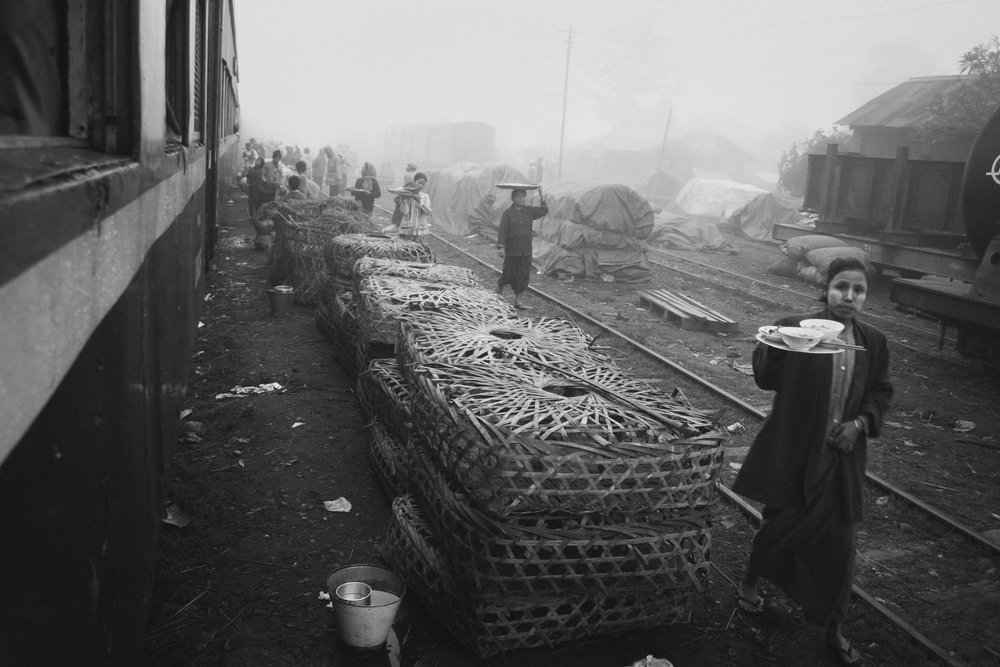 Women vendors at a misty train station in Sagaing Region, Myanmar, Burma. Photo by Daniel J. Powell