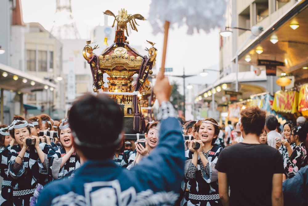 Women carry a mikoshi (portable shrine) at the annual Wasshoi Festival in Ueda, Nagano, Japan. Photo by Daniel J. Powell