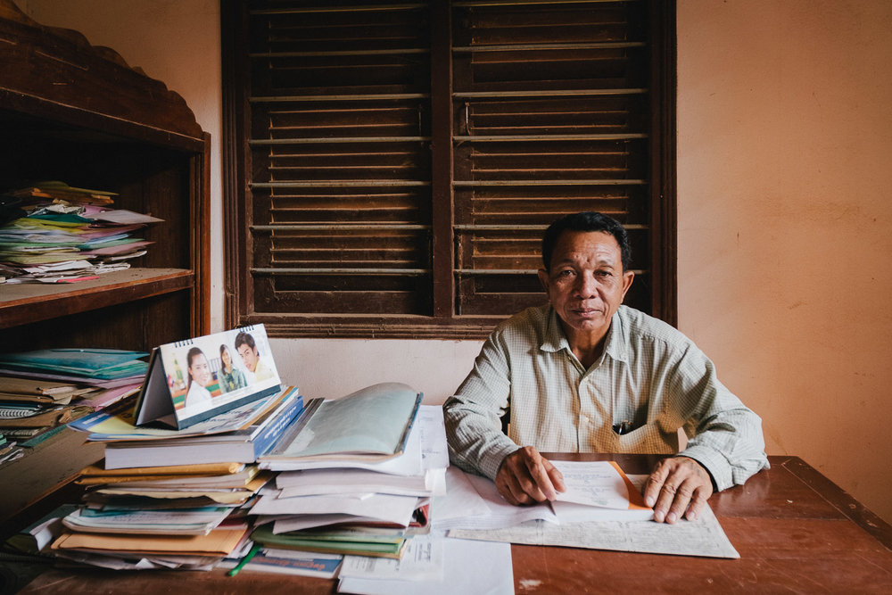 A local government official sits at his office desk in Kampong Speu Province, Cambodia
