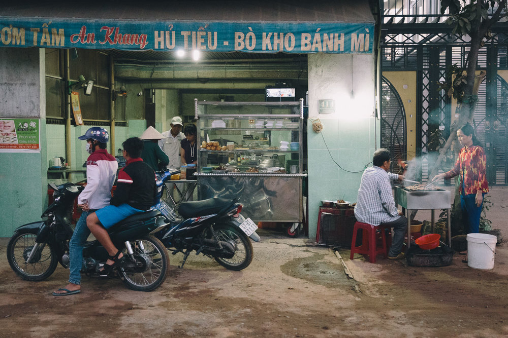 Street-side restaurant scene at 5:30 a.m. in Ho Chi Minh City, Saigon, Vietnam, District 9. Photo by Daniel J. Powell