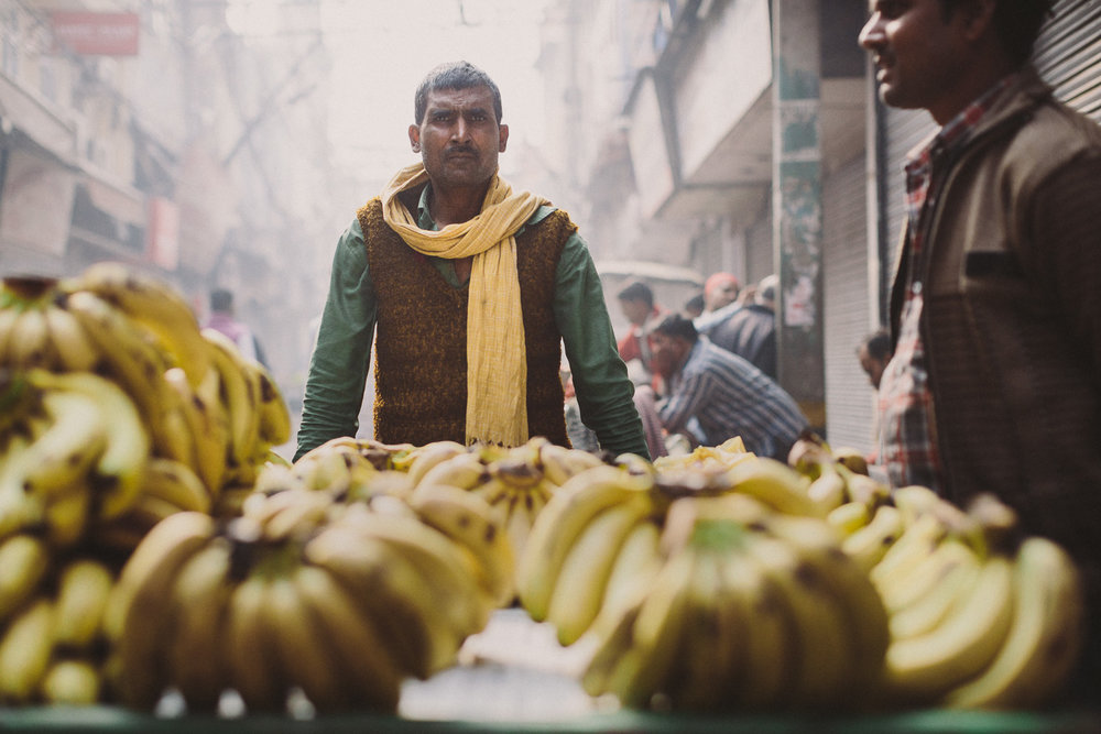 A well-dressed banana vendor on the street in Old Delhi, India