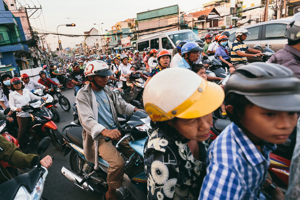 Motorbikes pack the street during rush hour in Ho Chi Minh City, Vietnam
