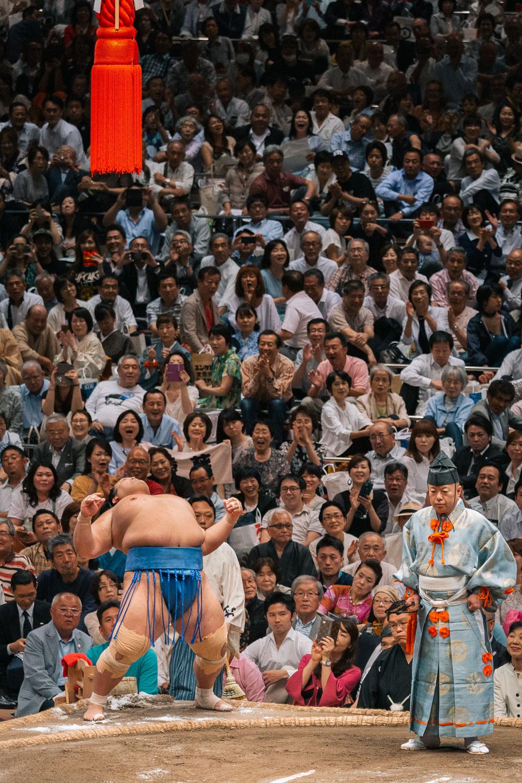 Japanese sumo wrestler Kisenosato Yutaka stretches before a match at Ryōgoku Sumo Hall in 2017 in Tokyo, Japan