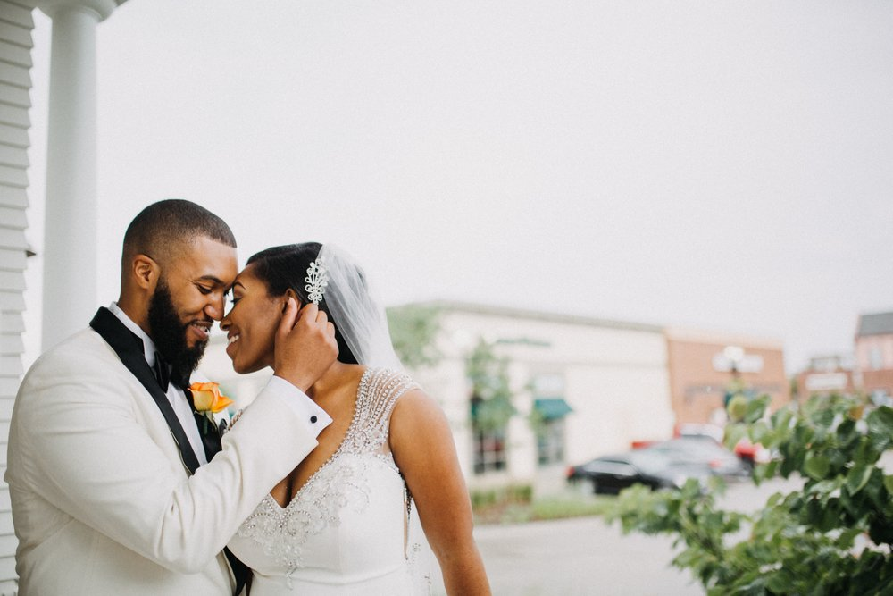 The rain didn't stop these two lovebirds from smiling! They just got MARRIED!