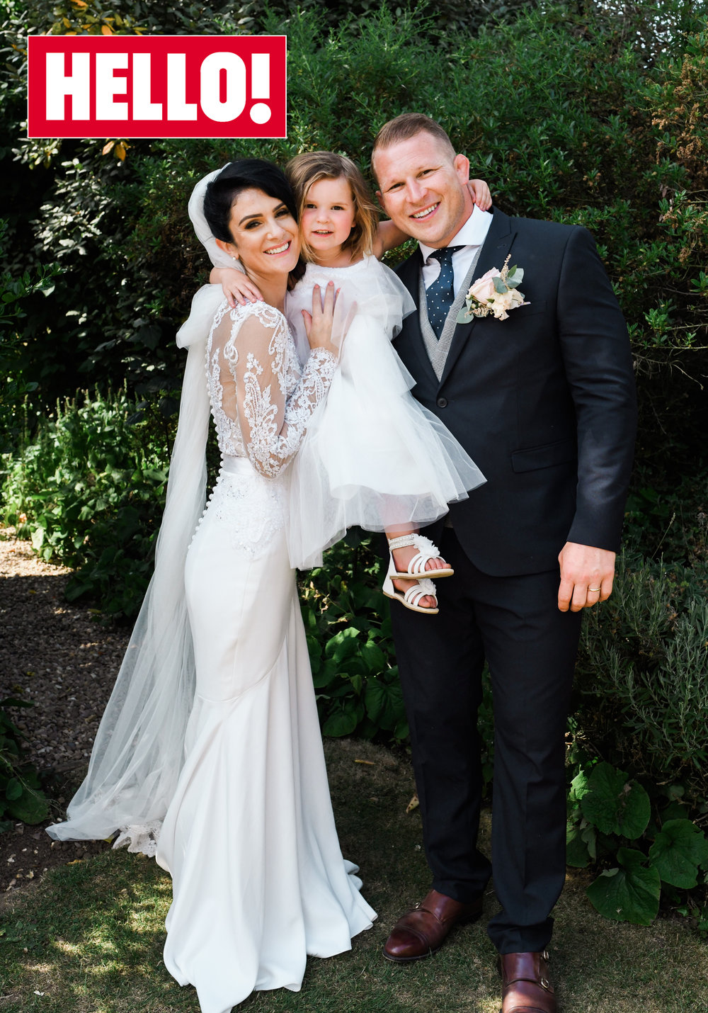 The radiant bride Joanne Tromans with her new husband, Dylan Hartley, as seen in Hello! magazine.