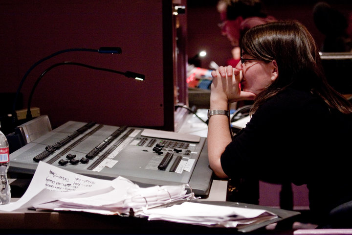 Rachel Dart in the booth on the road.