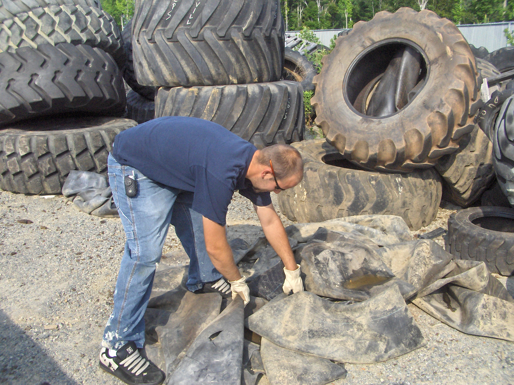 Kevin collecting inner tubes from a local tire center.