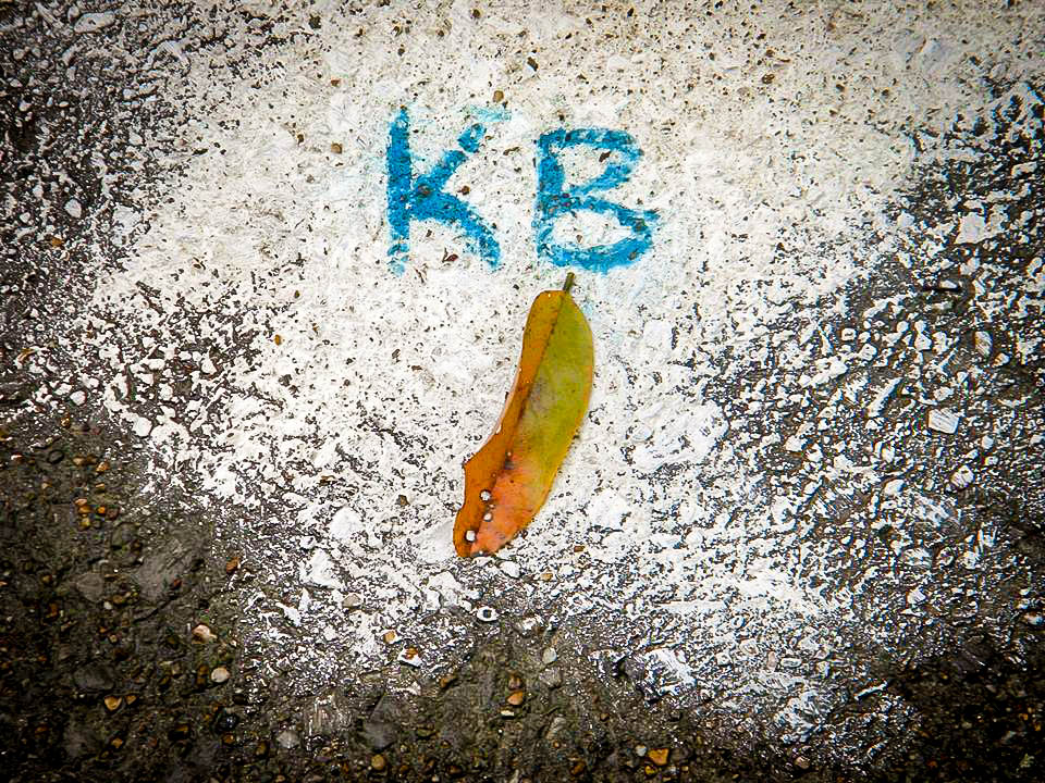 karla browns initials scribbled on pavement.jpg