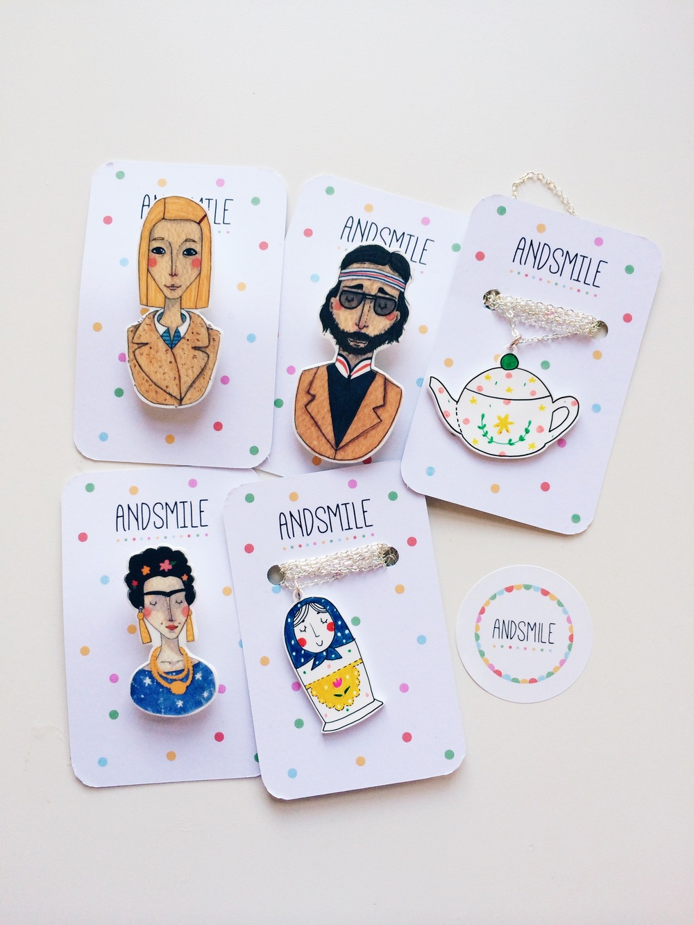 Frida, Margot & Richie are printed and Matryoshka & Teapot are hand drawn.