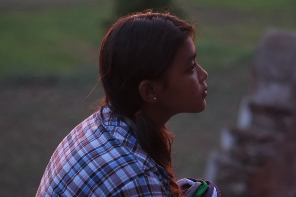 Burmese girl in the sunset - showing the effect of most colour being red shifted