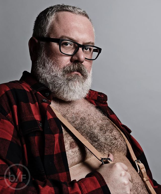 Dylan, 2017 NYC 🐻👓❤️ #bearflavoured #tummytuesday . . . . . . #picsbybears #gaybear #bearded #gaybeard #gaydaddy #daddybear #hairychest #hairy #beardedgay #portrait #photography #gay #nyc #beardedhomo #gaybears #bearscubsandbeards #bearweek #chestnutgear #lumberjack #lumbearjacks #checkedshirt #newyork #bowery #photography #portraitphotography #portrait #warbyparker #glasses