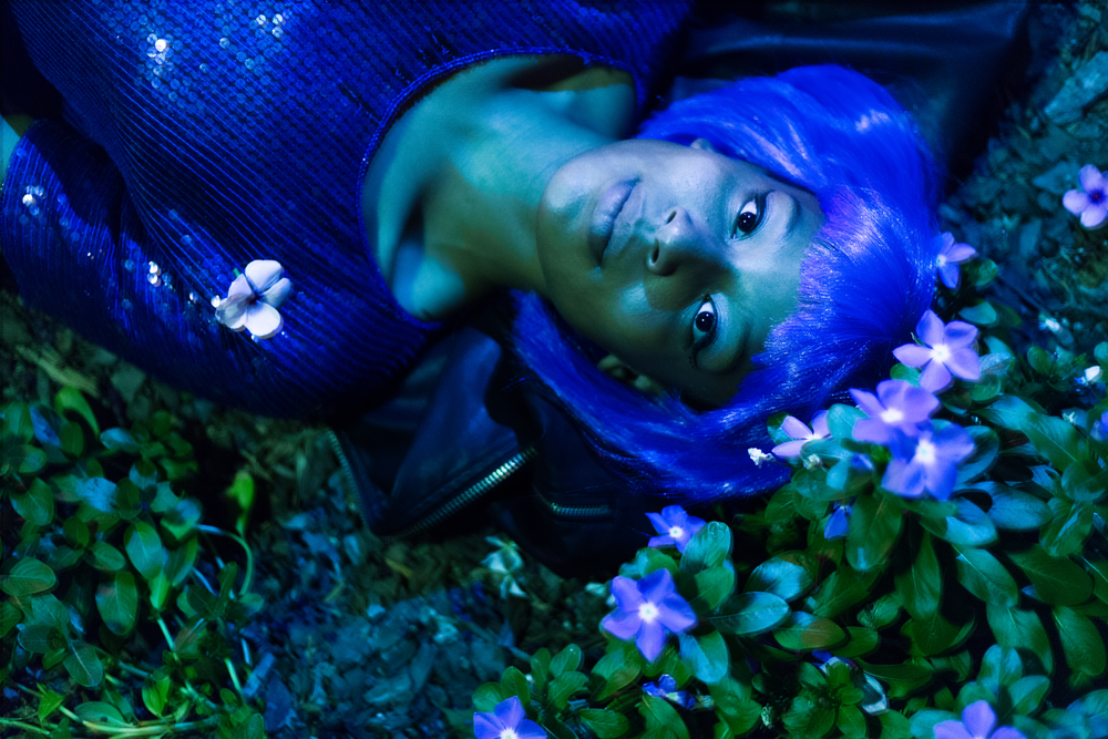 #8- This  shoot  was heavily inspired by Halsey's  Ghost video , which is absolutely dreamy and beautiful. I love the way the sequins on Tatiana's shirt look with the blue flowers and her purple wig.