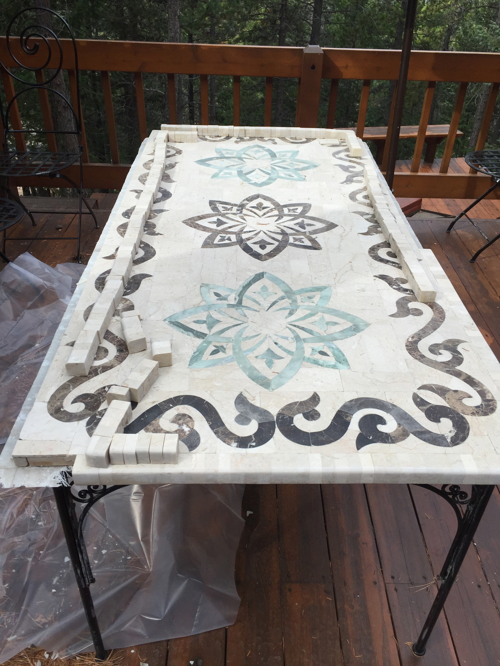 This table from Morocco was almost replaced. The resin along the edges  cracked due to the  extreme temperatures and the weight of heavy snow during a winter above 8500 ft. The marble was repaired and restored using a cold setting epoxy resin and diamond polished to a glossy finish.