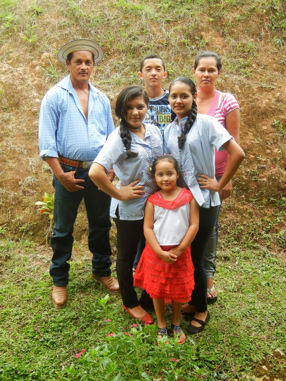 Zulai and family, dressed in their best for a school event.