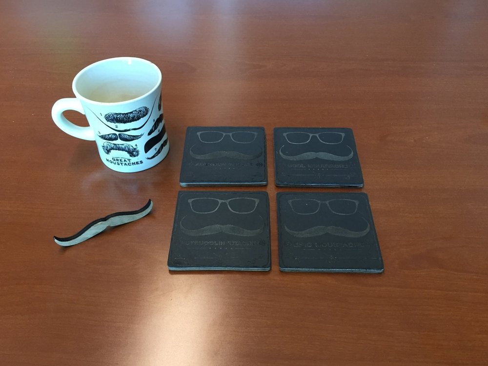 A personal project for my office. Laser engraved leather 'Stache coasters with individual taglines.