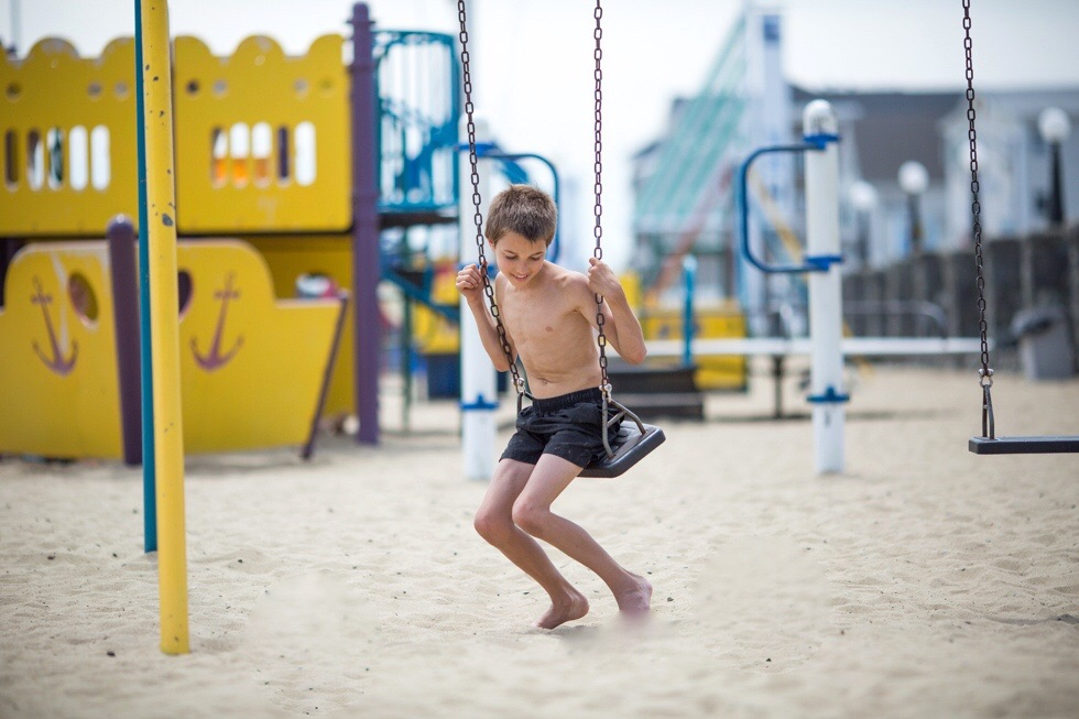The joy of not only the warm sand, but a playground!