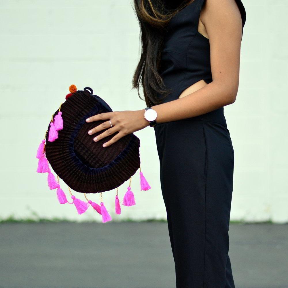 black-cutout-jumpsuit-monochrome-tassels-statement-accessories 4