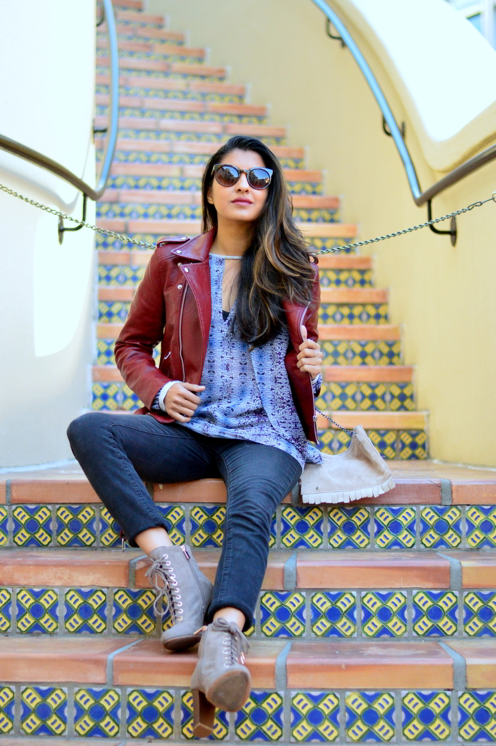 burgundy-leather-jacket-laceup-ankle-boots-casual-layers-winter-style-animal-print 1