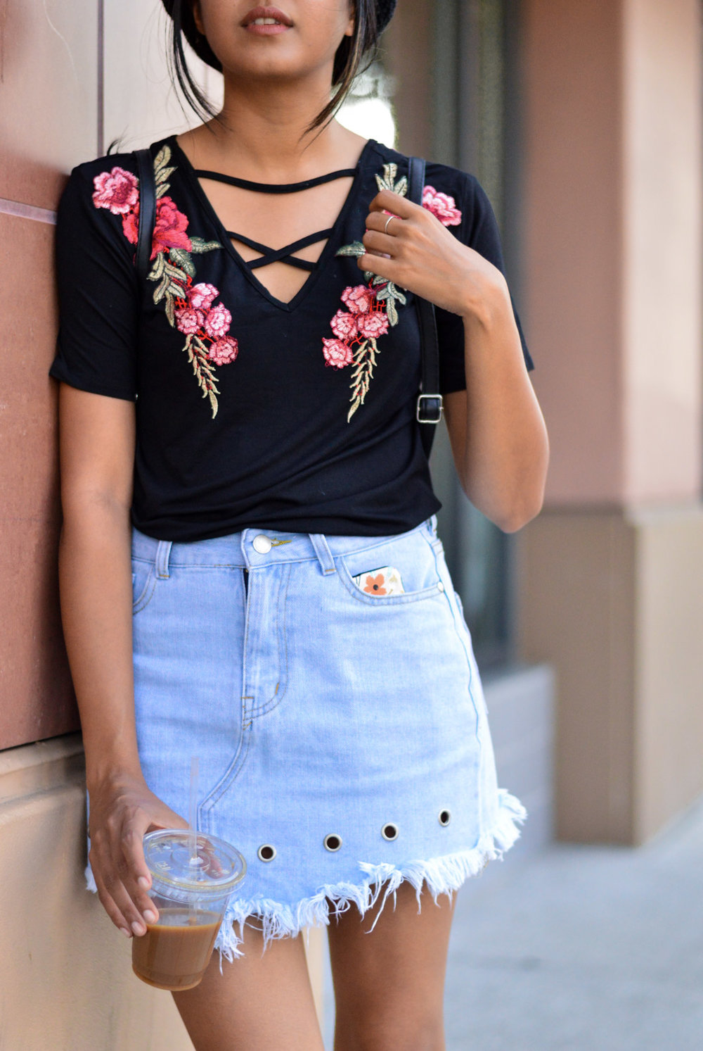 Casual-friday-style-denim-skirt-grommet-details-embroidered-tee 2