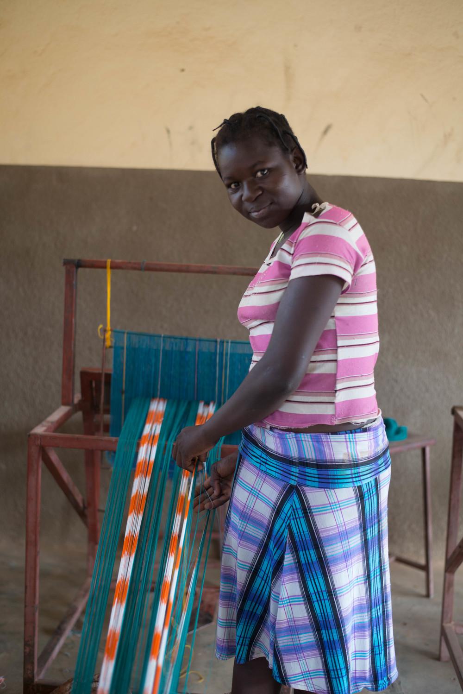 Germane untangling her loom.