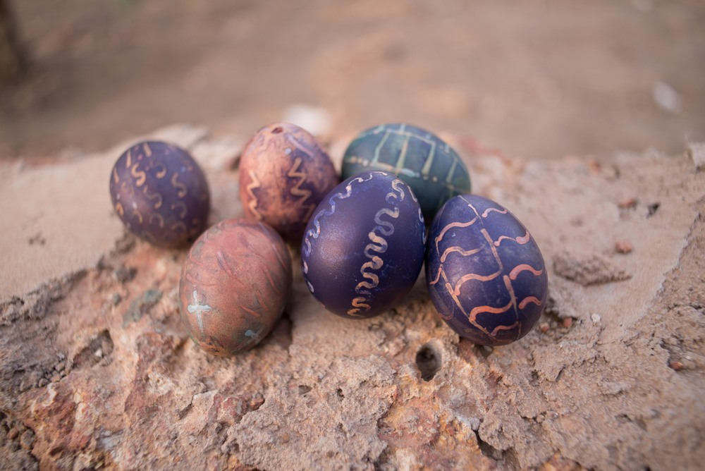 The ugliest Easter Eggs in the world, colored with powdered clothing dye and vinegar with wax resist motifs courtesy of a box of candles and the head of a pin.