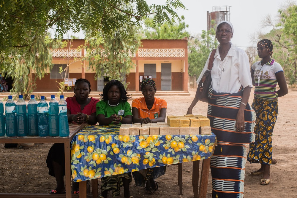 The girls and Sister Elisabeth selling soap.