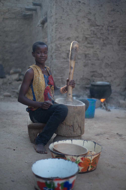 Zarimatou, 13, pounds maise in Zoro
