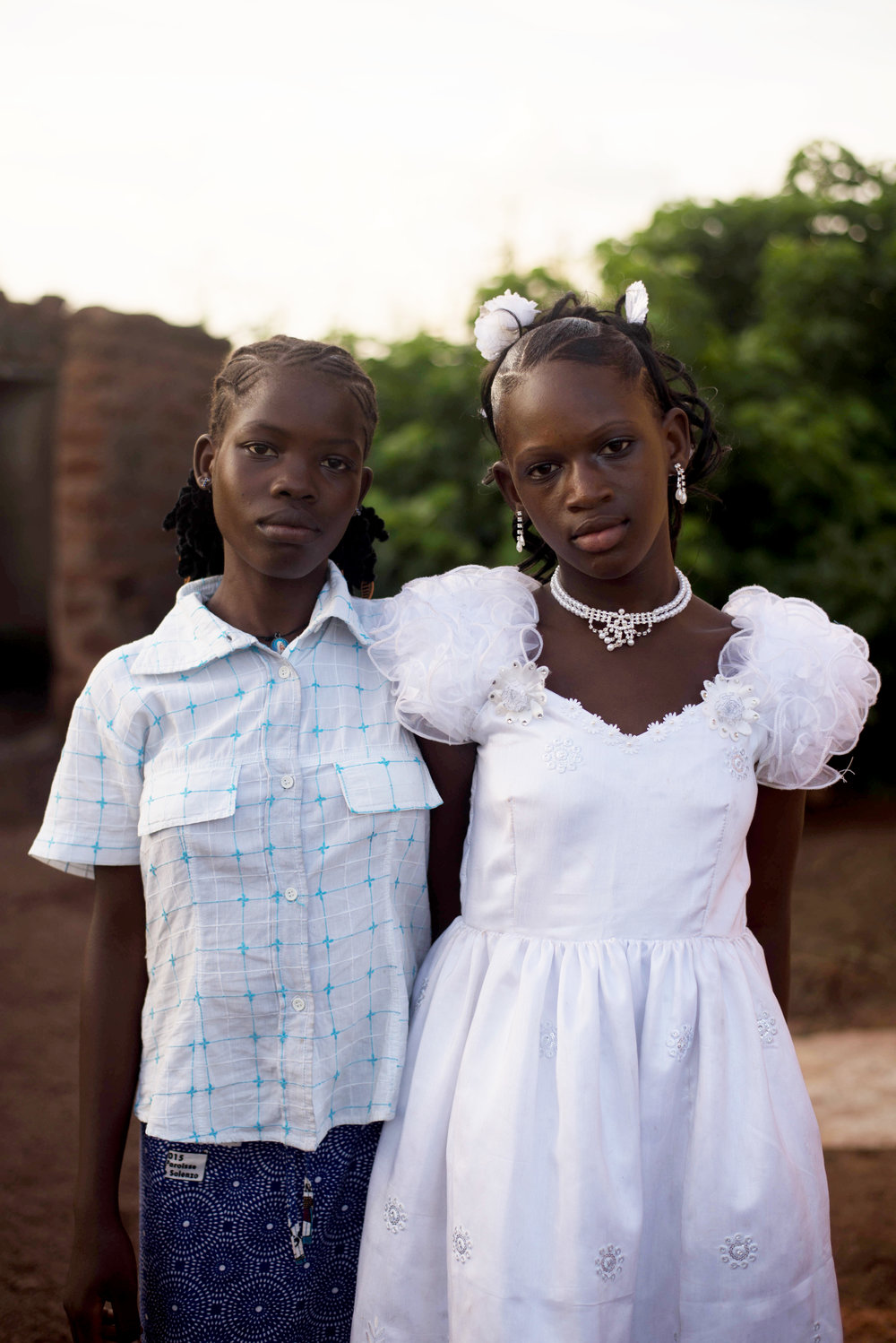 Badjah (left) and Kevine (right), Rita's daughter, on the day of Kevine's baptism.