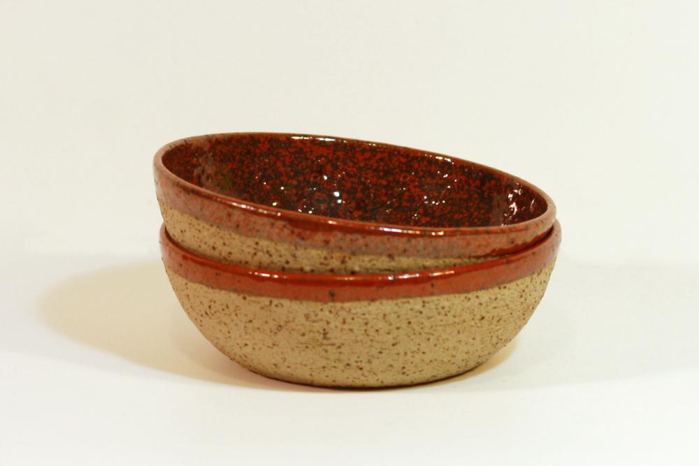 Raku bowls with redglaze
